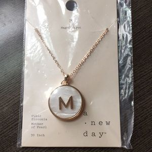 a new day M initial long pendant